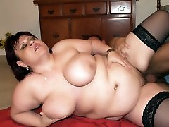 Aged babe in nylons Marta cupping her breasts while a cub pounds her on the floor