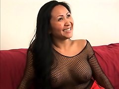 Fellow gets a foot job from a cute asian in fishnets