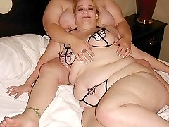 Two cute fatties roll around in bed together