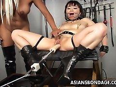 Beautiful blonde bitch dominates the mega-slut with a fuck machin