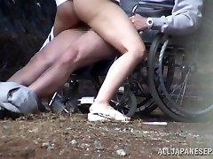 Horny Asian nurse deepthroats cock in front of a voyeur