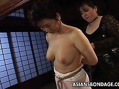 Mature bitch gets roped up and strung up in a bdsm session