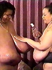 Cajun Queen is a sexy diva with some amazingly large boobs.  Don't miss out on seeing her as she enjoys herself in the bath tub, as well as getting freaky with her equally huge boobed girlfriend
