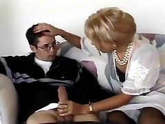 Retro model victoria strips down to nylons garters and granny panties