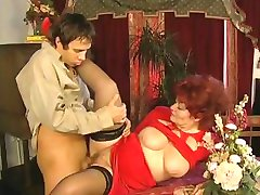 Red-haired granny spreads her stockinged legs and gets her bushy hole worked out