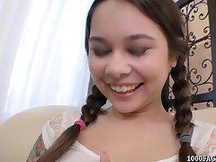 Pigtailed teen Kira Sinn eagerly taking cum facial