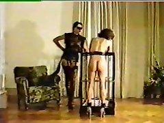 Mistress tortures and brands fresh female slave