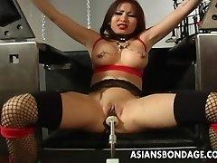 Busty brunette getting her wet snatch machine drilled
