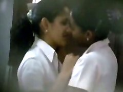 Two cute latina schoolgirls caught kissing and fondling by a peeper