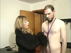 Mistress Cristian fooling around with her slave guy