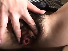 Asian lass with a hairy cunt masturbates on a toilet seat