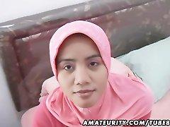 Arabi, amatööri vaimo, kotitekoinen suihinotto ja panna kasvojen