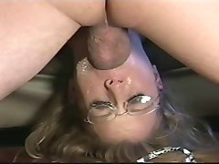 Girl with glasses is gagging