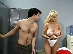 Middle-aged cheerleader with gigantic bust still fucks with football players in locker room