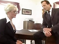 Busty secretary fucked in stockings and a garter