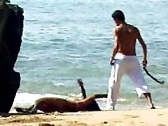 Getting whipped and fucked right on the beach makes this submissive brunette cum hard