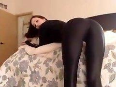 Stunning black latex catsuit girl