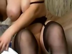 I am this naughty slut with huge amateur tits, who is wearing high high-heeled slippers, while fucking a massive black dildo.