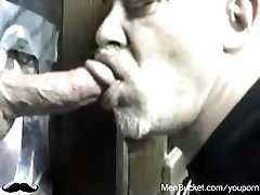 Mature first-timer dudes eating rods from gloryholes