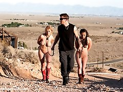 In a post apocalyptic future, Darling and Casey Calvert are captured by a savage hunter who sexually torments them with bondage and rough sex.  This feature presentation fantasy movie includes hard bondage, anal sex, rough blowjobs, role-play and intense orgasms!