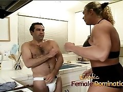Angry dominatrix with gigantic muscles hurts her husband
