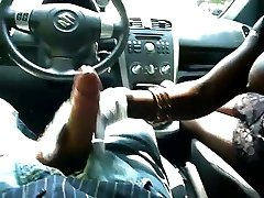 Ebony girl with big mounds gives handjob in car