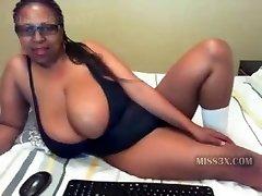 Dark-hued mom and her mega big boobs