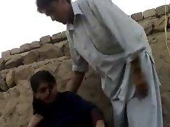 muslin teen with boy in feild
