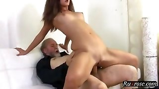 Russian woman having sex with an old bearded guy