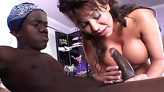 Buxomy brown-haired with nice ass gets a cunnilingus from the midget
