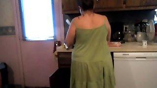 Mother Upskirt preparing dinner (sexy green dress and panties)