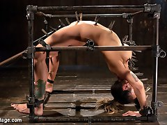 Big titted Nadia Styles submits to Orlando and his brutal bondage box.  She is contorted, stretched out, and fucked every way this sadistic fuck can imagine. Squirting orgasms, anal fucking, and brutal bondage leave this slut begging for more.