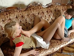Vivacious chicks rubbing against each other with their soft silky tights on