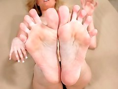 Blonde toys with a thick cock with her red painted toes