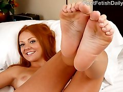 Farrah gets caught using her new toy by her boyfreind. Her man knows how to make her cum so he licks and sucks her perfect feet. She gets so turned on that she has to see his hard cock sliding between her wet toes. She gives him the best footjob and then they fuck all over the bed until he cums all over the tops of her creamy feet.