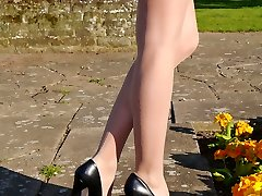Classy babe Cheryl shows off her marvelous lengthy legs and ebony leather stiletto heels