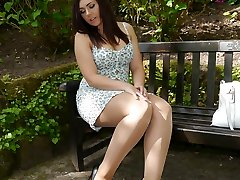 Brunette stunner Lauryn taunting in the park in a pair of totally fashioned nylons and black stilettos