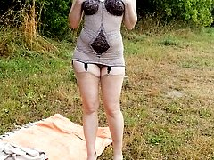 Wanilianna out in the fields showing off her curvy figure in retro corselette!