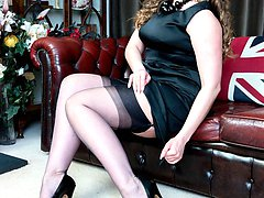 Sophia aching to strip and show you a bit more than her classic black FF nylons and leather...