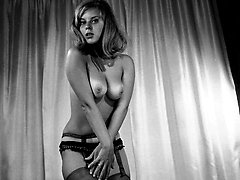Gal in retro lingerie gets her rocks on posing on camera and showing her nice tits with...