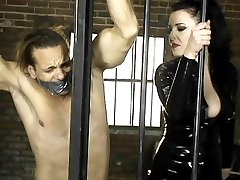 Anastasia Pierce punishes her love slave with a gag and putting him behind bars