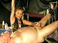 Merciless mistress trains her mature male slave pushing a tube into his dick