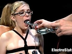 Episode 2: The last time you saw these girl they were strung up like a couple of little blonde birds. This time around I have them strapped to a box back to back with their pussies spread wide, open and on display for my electro enjoyment. With both girls legs tied and spread wide, I penetrate one girl with an electro double penetration and the other with the largest electro plug we have in stock.Both girl struggle in their bonds to get away from the high volts of electricity but they are tied too tight. Fortunate for me, they are not tied too tight to eat my cunt, dripping wet from watching them suffer.