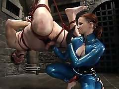 Claire Adams takes Her slave to new painful heights as She uses him as rug, hangs off his...