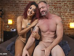 When slave D. Arclyte doesn't pay his weekly tribute to Goddess Daisy Ducati she decides to surprise him by showing up at his house to pay him a little visit. Daisy catches him rifling through porn mags and decides that this little slave slut needs to be denied. She fucks her pussy with a dildo that's attached to his chest while he is gaged with an open mouth funnel so that very single drop of her delicious squirting cunt fills his mouth and in order to breath he must continue to swallow it all. She has his cock cinched in a metal cage and even squirts her juice all over his cock. This is the closest he will ever get to Daisy glorious cunt!