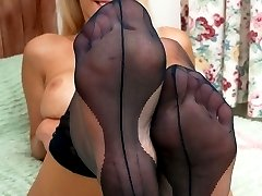 Taylor showing off her sweet heavenly soles on the bed in ff nylons!