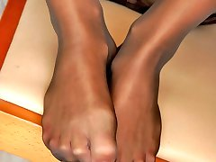 Curly chick in earth shoes fondling her feet clad in suntan open toe tights