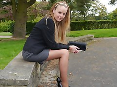 Cute Claire is outdoors in tall black high heel shoes and sexy nylons showing off her lovely...
