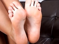 Elle Brook peels of her nylons to bare foot tease!