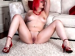 Emma posing naked in red stilettos!